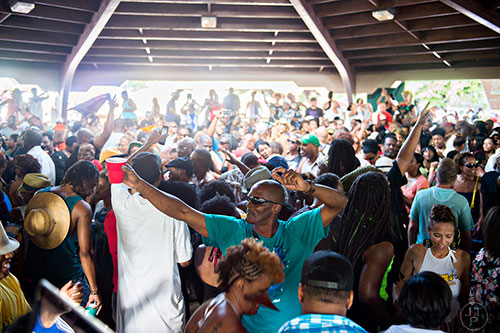 Photo: Jonathan Phillips Darryle Clarke (center) dances amidst the throngs of people during House at the Park at Grant Park in Atlanta on Sunday, September 6, 2015.